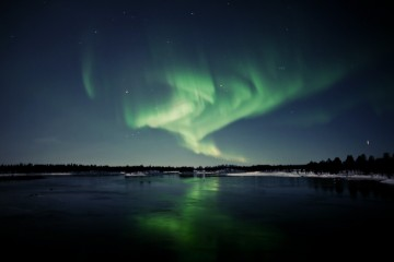 Adventure Travel Photo of the Day - Jade Reflections, east of Ivalo, Finland - Natalia Robba