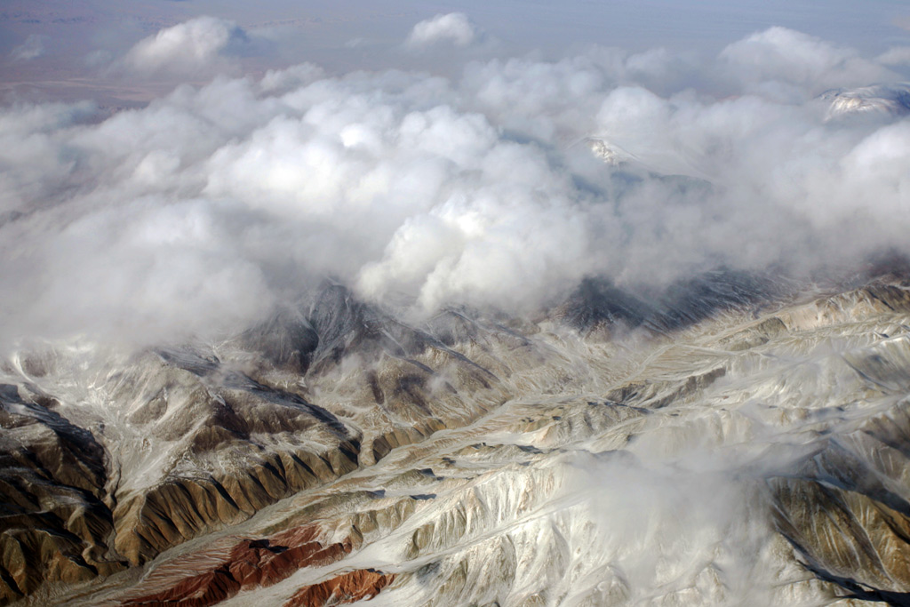 Adventure Travel Photo of the Day - www.letsbewild.com - Above the Clouds, Tarim Basin, Xinjiang Uyghur Autonomous Region, China - Mathias Ortmann