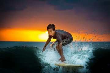 Adventure Travel Photo of the Day - www.letsbewild.com - Young Surfer, Jimbaran Beach, Bali, Indonesia