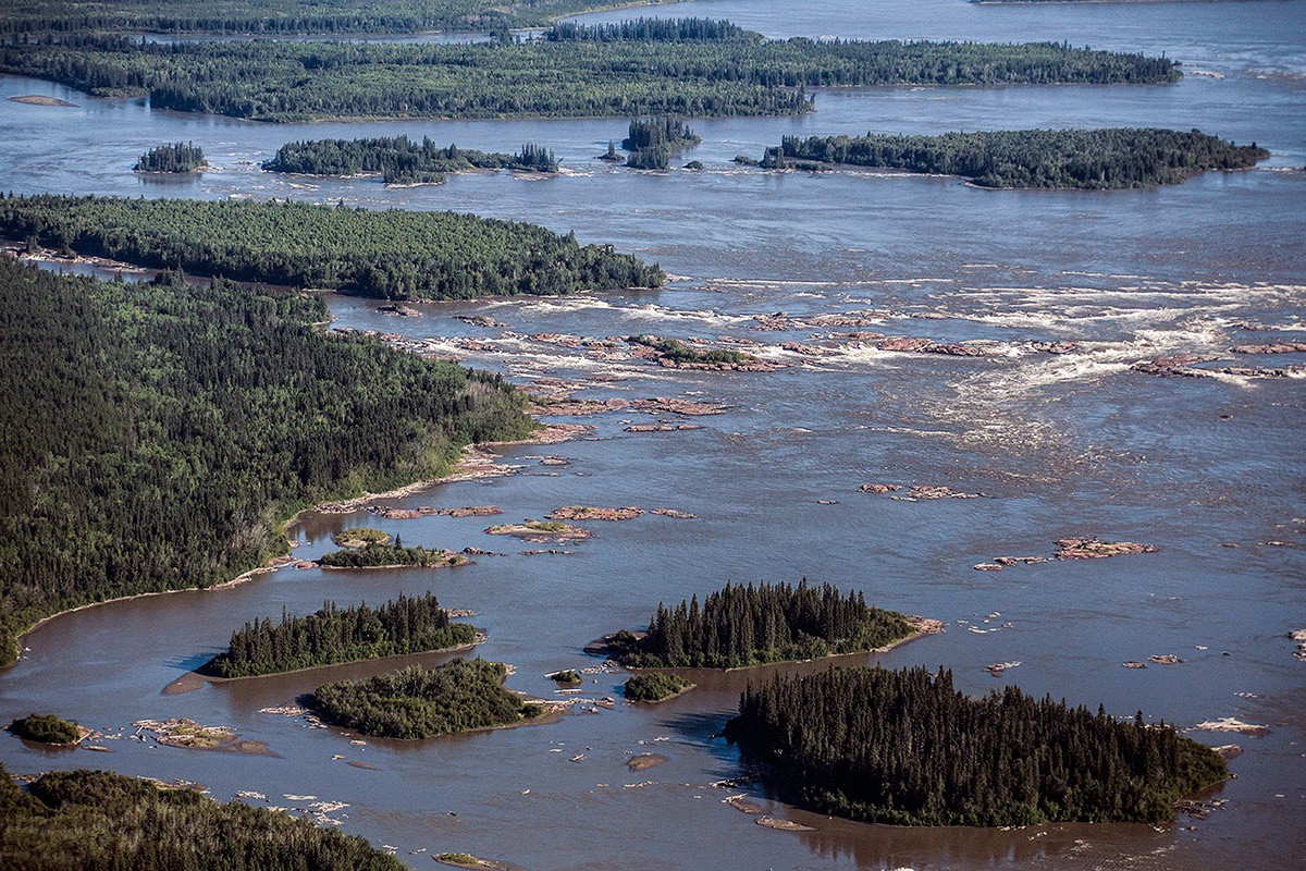 In some areas the Slave River can be as wide as 3 kilometers, it cuts through the edge of the Interior Plains and runs along the eastern side of Wood Buffalo National Park. It follows a fault in the Canadian Shield known as the Rutherford Fault and some of the red-tinted rocks in this region are over 400 million years old! ©Parks Canada - Photo by Karl Johnston